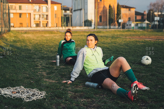 Football players taking break on pitch