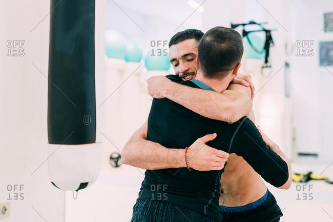 Male friends hugging