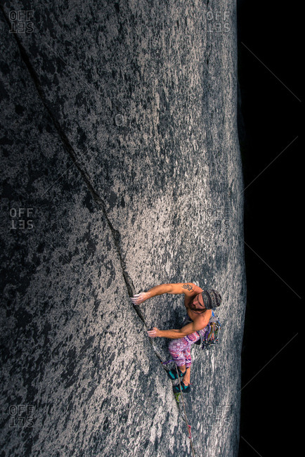 Man climbing rock face on Malamute, Squamish, Canada, high angle view