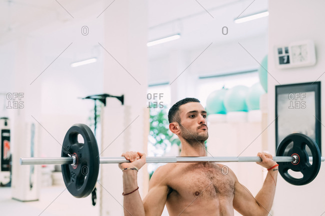 Man weightlifting using barbell