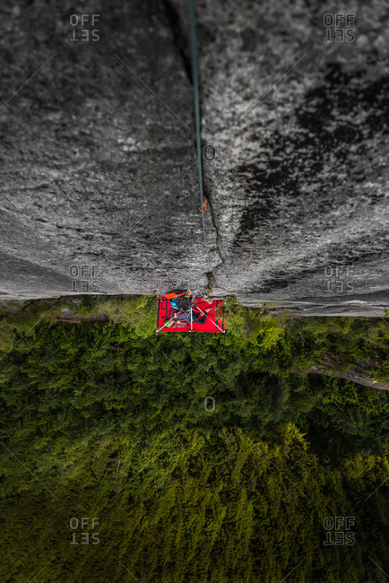 Woman on portaledge, Tantalus Wall, The Chief, Squamish, Canada, high angle view