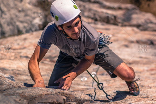 Young man, sport climbing, elevated view, Skaha Bluffs Provincial Park, Penticton, Canada