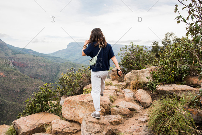 Young female tourist exploring The Three Rondavels, Mpumalanga, South Africa