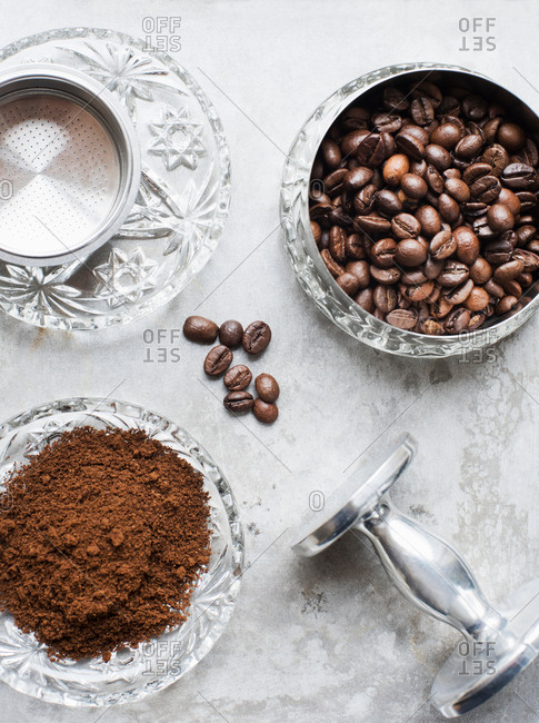 Bowls of fresh ground coffee and coffee beans, overhead view