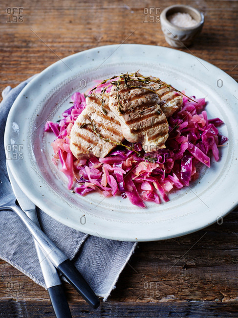 Grilled pork on braised red cabbage, close-up