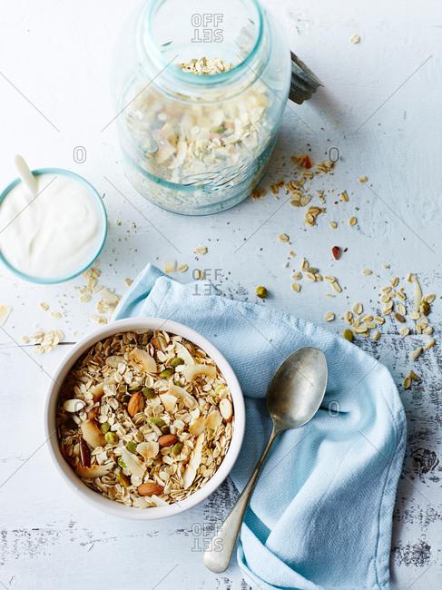 Still life of nut muesli and yogurt, overhead view