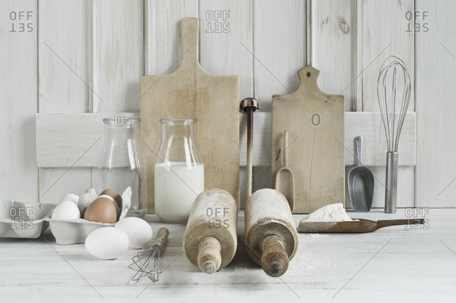 Kitchen utensils- rolling pin- wire whisk- shovel- chopping board- eggs- flour and milk