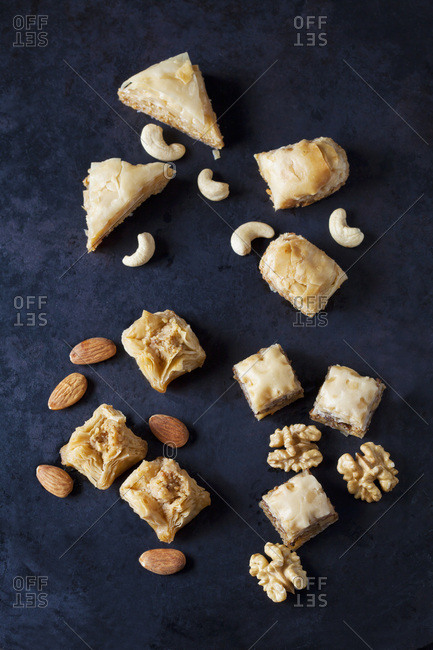 Baklava and nuts on dark ground