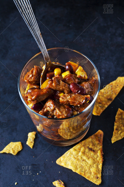Vegetarian Chili with soy meat cut into strips in glass