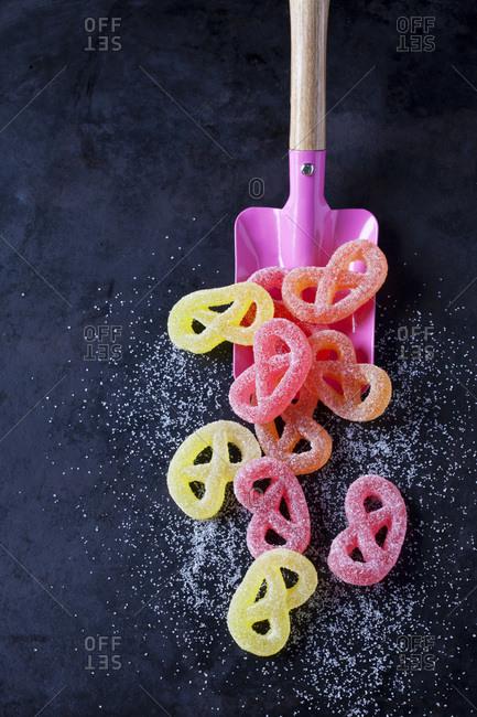 Sugar Pretzels and pink shovel on dark ground