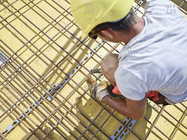 Construction worker fixing