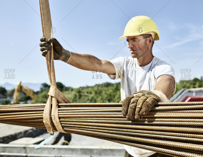 Construction worker with construction steel on construction site