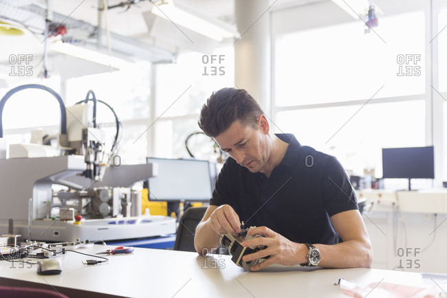 Man working on product in factory