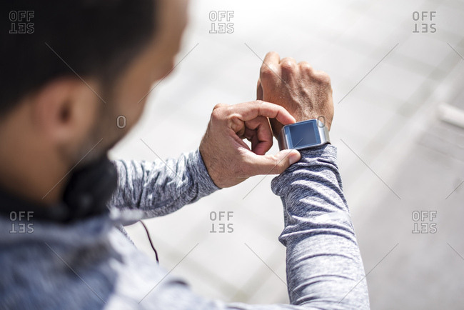 Close-up of athlete checking smart watch