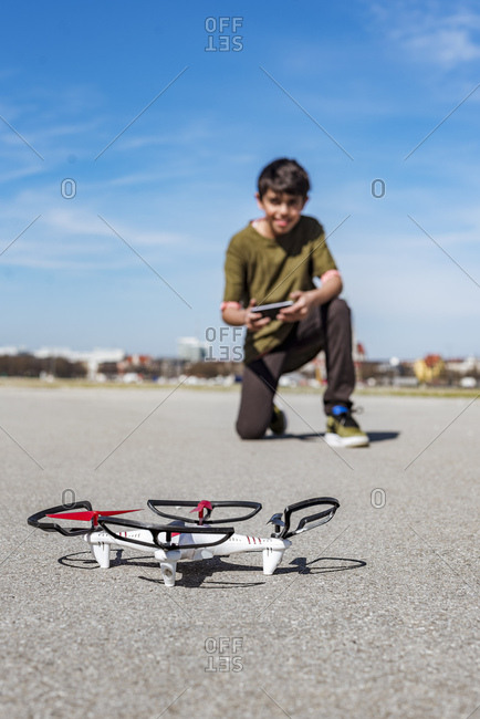 Boy flying drone