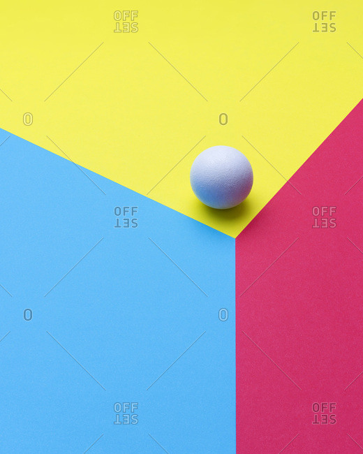 Sphere at the edge of a colorful cube