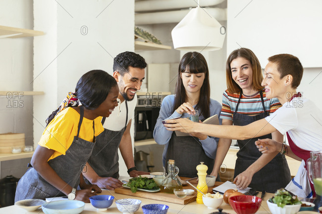 Happy friends and instructor in a cooking workshop