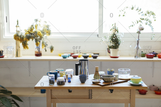 Empty kitchen with dishes on wooden table