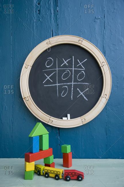 Chalkboard- toy train- toy blocks- tic tac toe