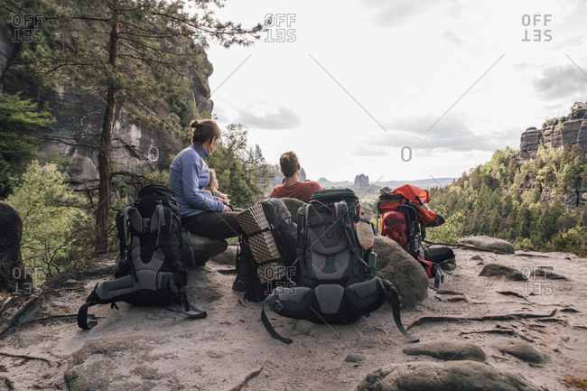 Germany- Saxony- Elbe Sandstone Mountains- friends on a hiking trip having a break