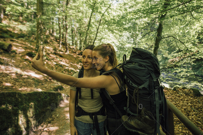 Two young women on a hiking trip taking a selfie
