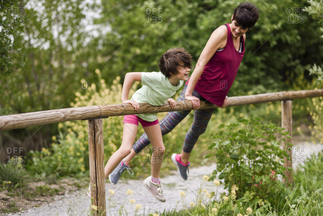 Mother and daughter having fun in nature environment