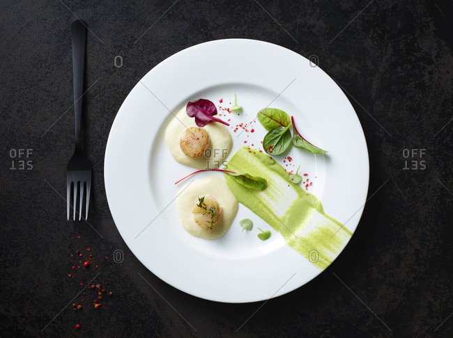 Scallops on nut butter with pea and mint puree