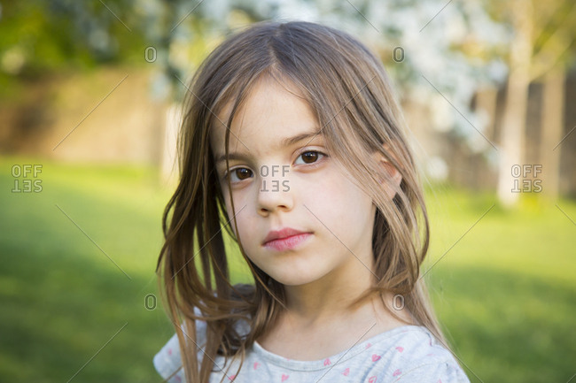 Portrait of little girl in the garden