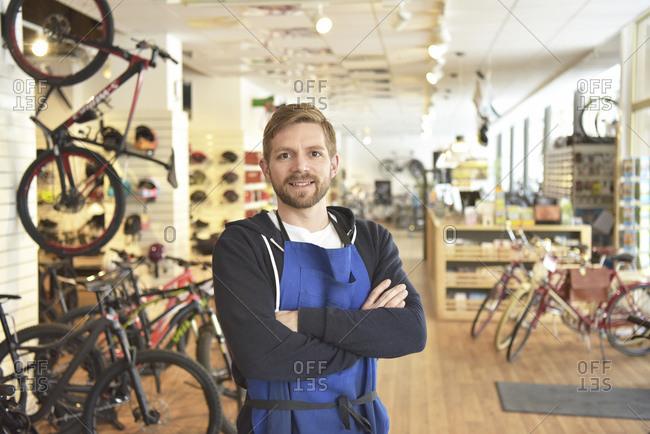 Bicycle mechanic in his repair shop- portrait
