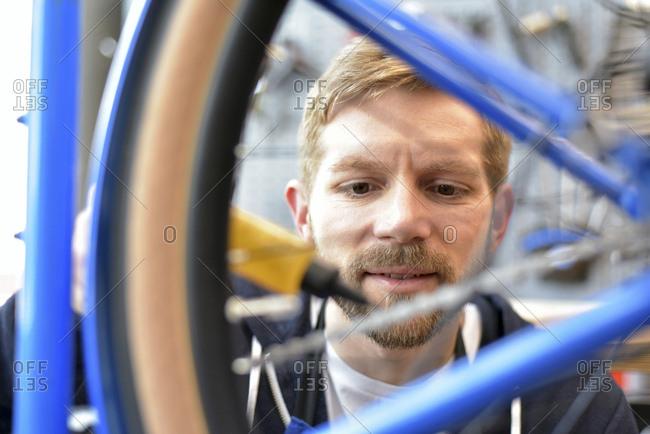 Bicycle mechanic lubricating bicycle chain