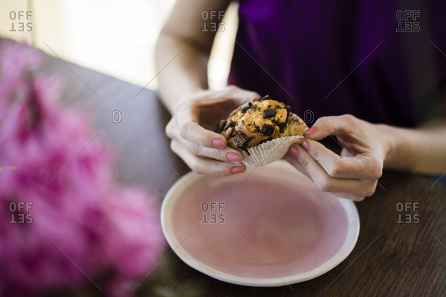 Woman's hands holding muffin