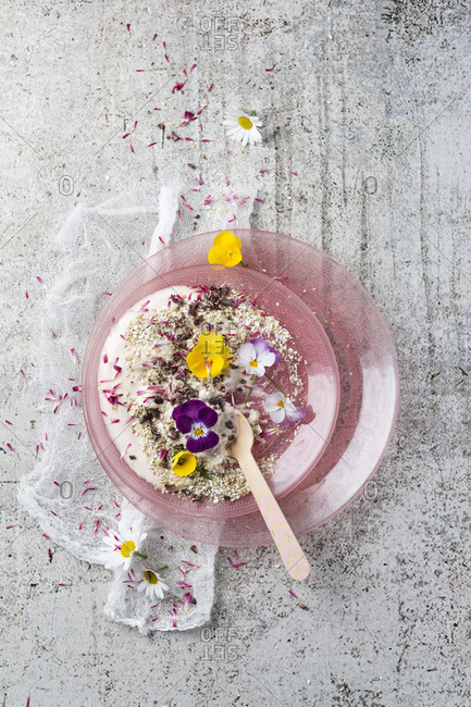 Natural yoghurt with buckwheat grits- edible flowers and cacao nibs