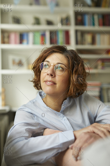 Portrait of pensive mature woman at home