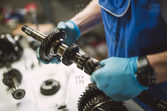 Close-up of mechanic working on the parts of a car in a workshop