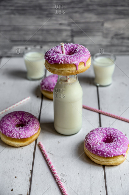 Pink doughnuts and bottle of milk