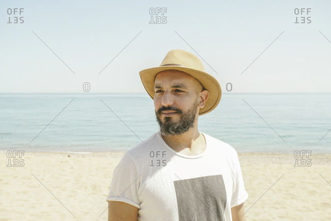 Portrait of a man wearing hat at the beach