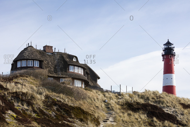Germany- Schleswig-Holstein- Sylt- Hoernum- thatched-roof house and light house