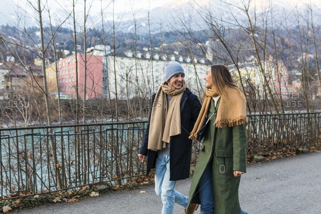 Austria- Innsbruck- happy young couple strolling together at winter time