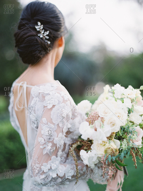 Bride with dark hair wearing floral gown