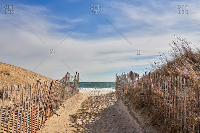 Sandy path leading to the ocean in Rhode Island