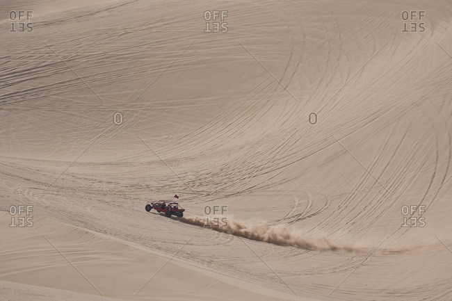 Dune buggy driving through the Imperial Sand Dunes, California
