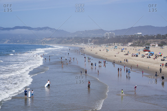 Santa Monica, California - April 8, 2018: Beachgoers on the coast of Santa Monica, California