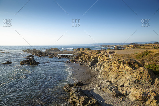 Coastal seascape of sunset at Glass Beach in northern California on a beautiful and warm summer day