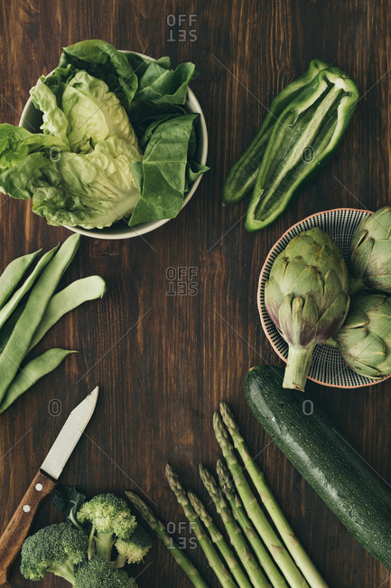 Variety of green vegetables on a wooden table
