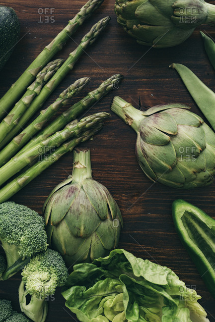 Green healthy veggies on a wooden table