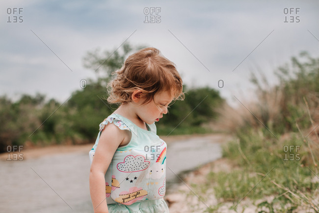A little girl playing on a sandy beach