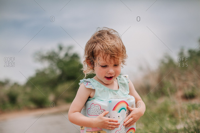 A little girl on a sandy beach