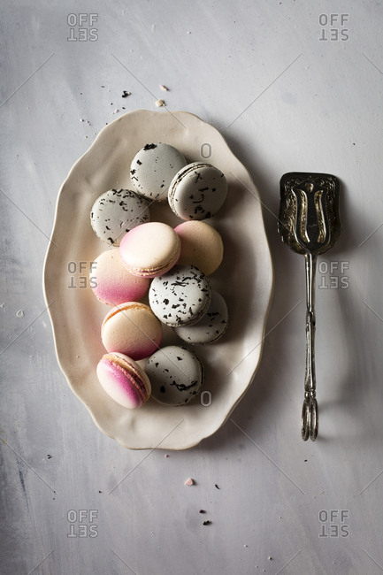 Freshly baked macarons on a plate with vintage server