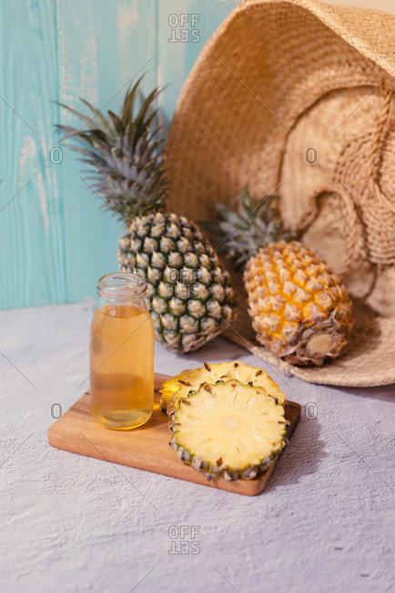 Bottle of pineapple juice with sliced pineapple fruit