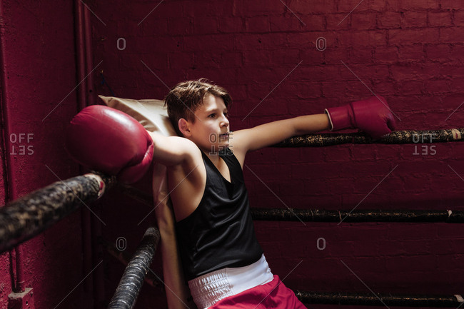 Young boy boxer training in the gym